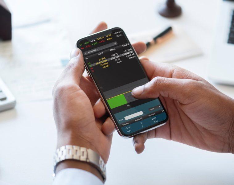 businessman-cellphone-checking-905869